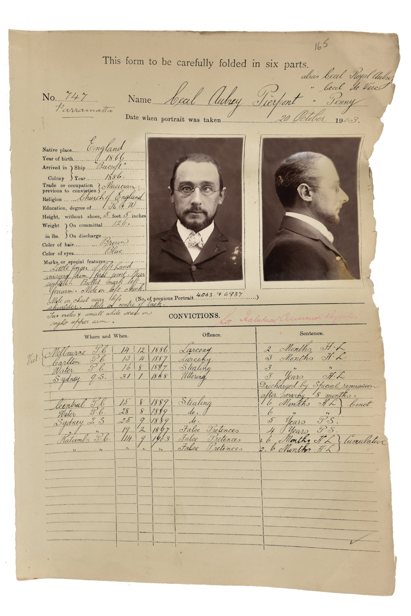 Slightly damaged document with small photo attached with written details of prisoner.