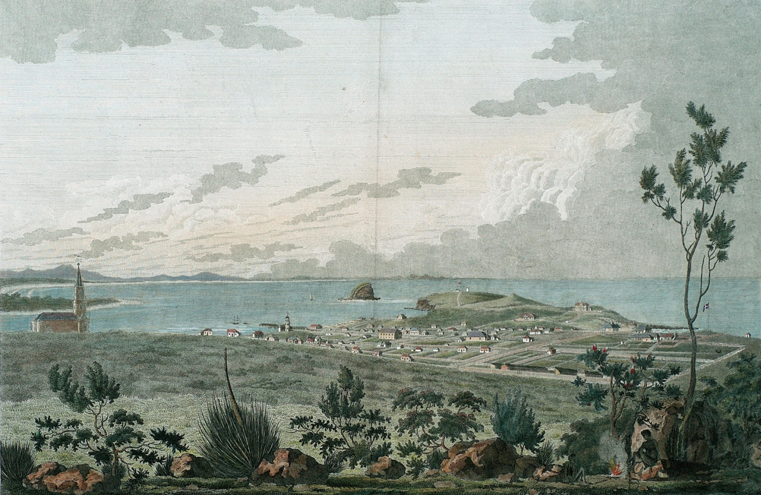 Lithographic image of a view from a lookout over coastal town with church, village and a river mouth opening to ocean with a large stony bluff at the end of a peninsula