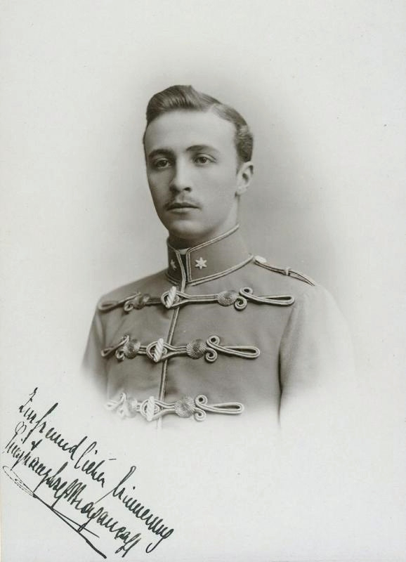 Black and white portrait of young uniformed man with signature across photo.