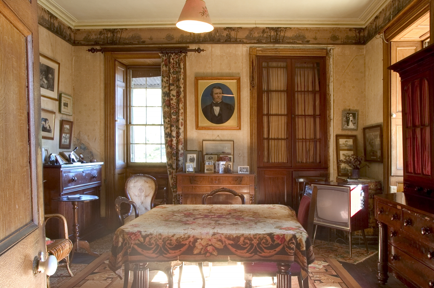 Interior of room set up with original furniture.