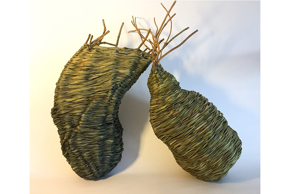 Two woven basket sculptures.