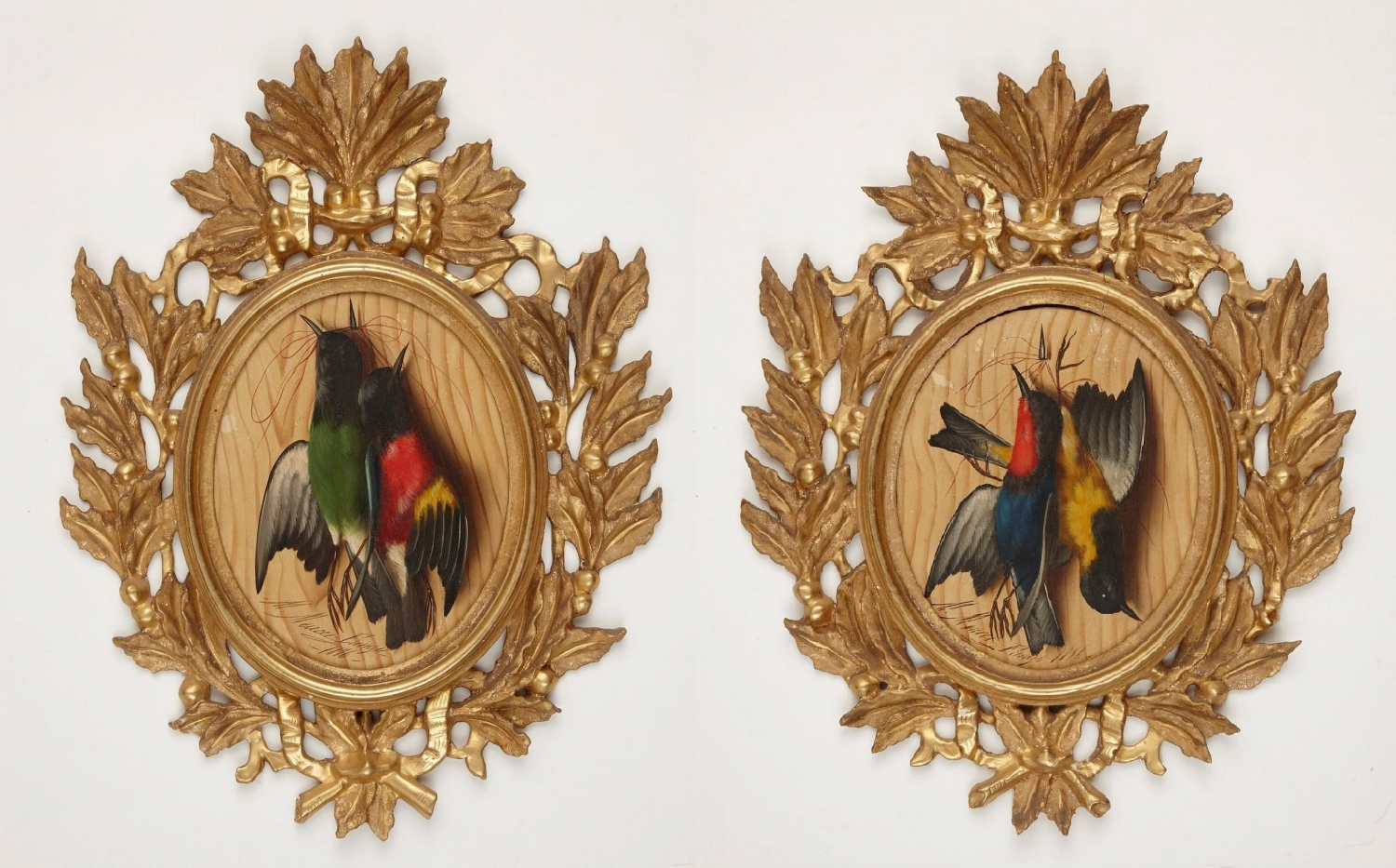 Two sets of stuffed birds in wooden frames.