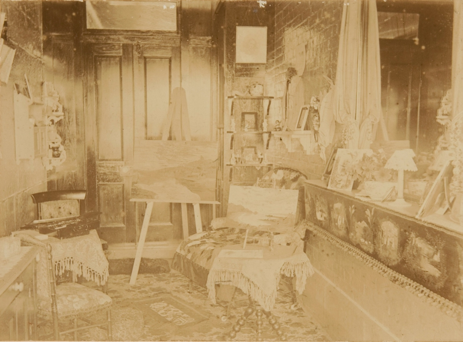 Slightly faded old photo of interior of art studio.