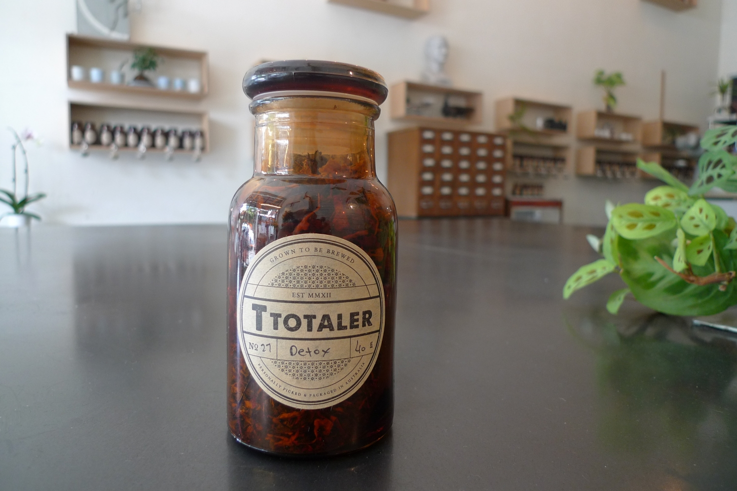 Photo of apothecary jar filled with tea