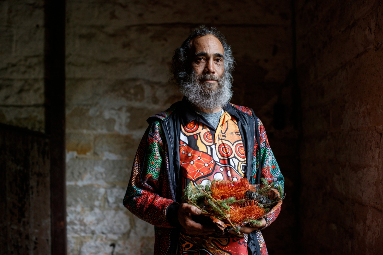 Man in colourful patterned shirt.
