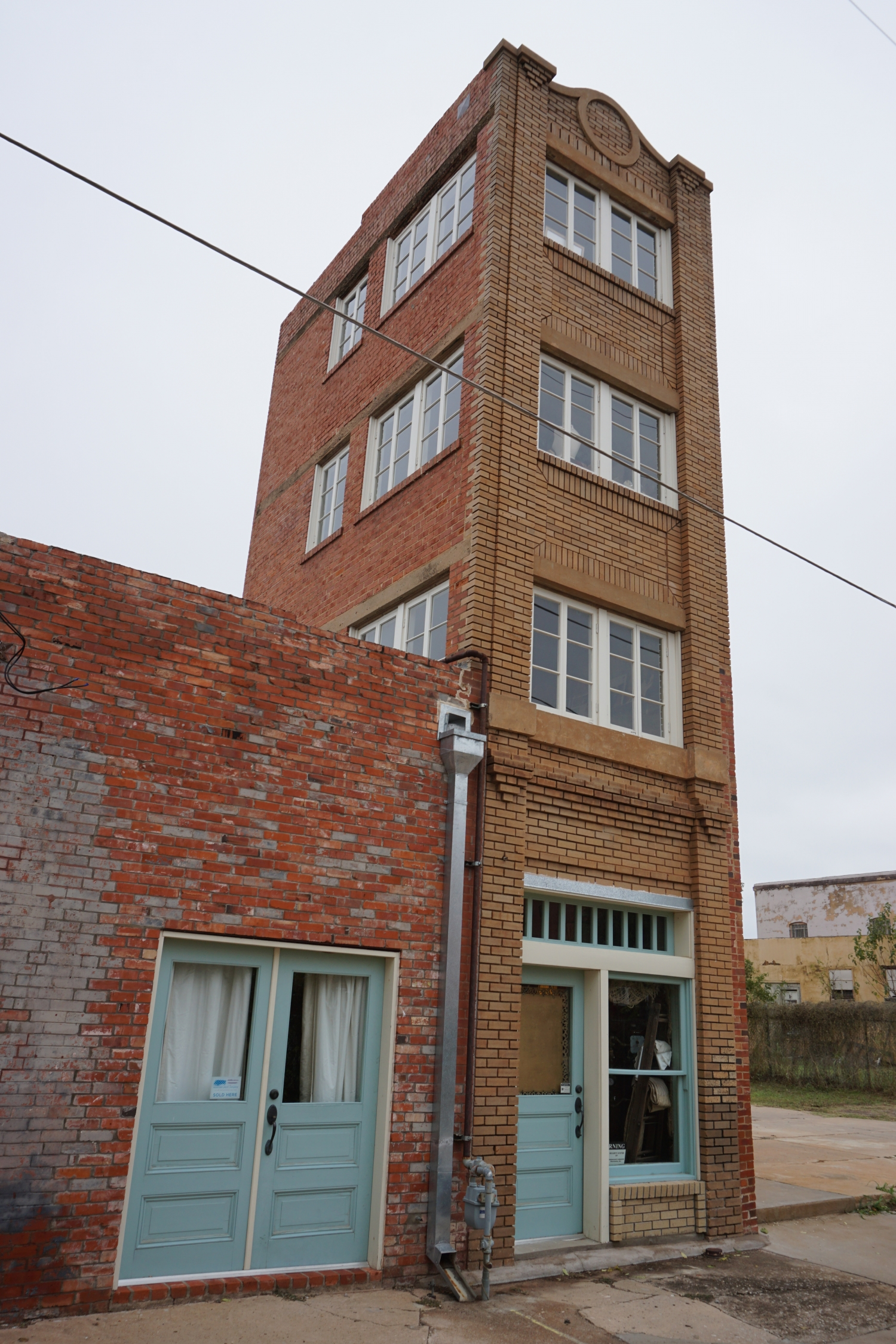 Tower attached to building.