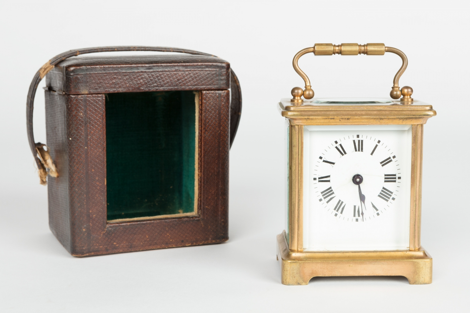 Square faced gold clock with matching square leather case.