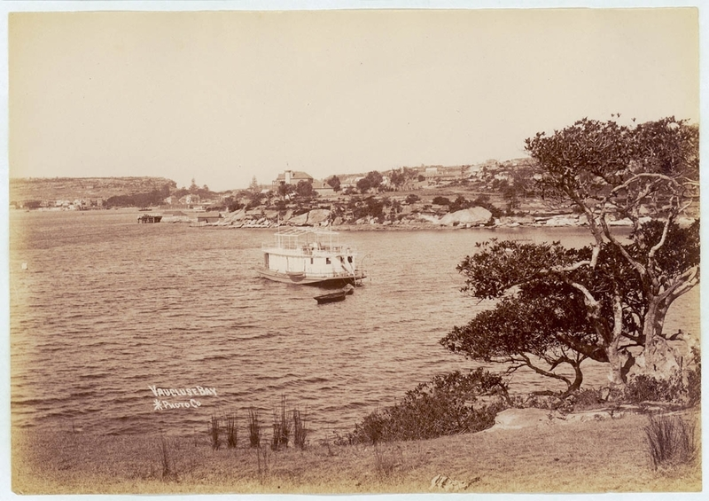 Black and white photograph of a houseboat in a bay
