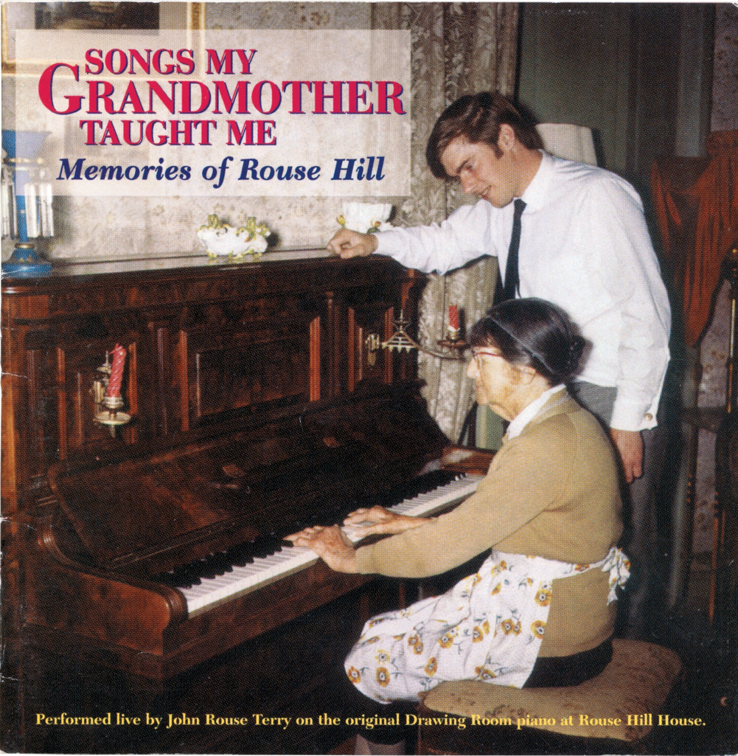 Cover of album with woman seated at piano playing while young man looks on.