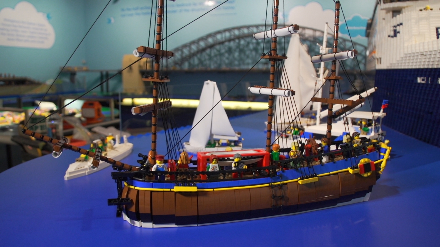 Colourful model of three masted tall ship built in LEGO bricks.