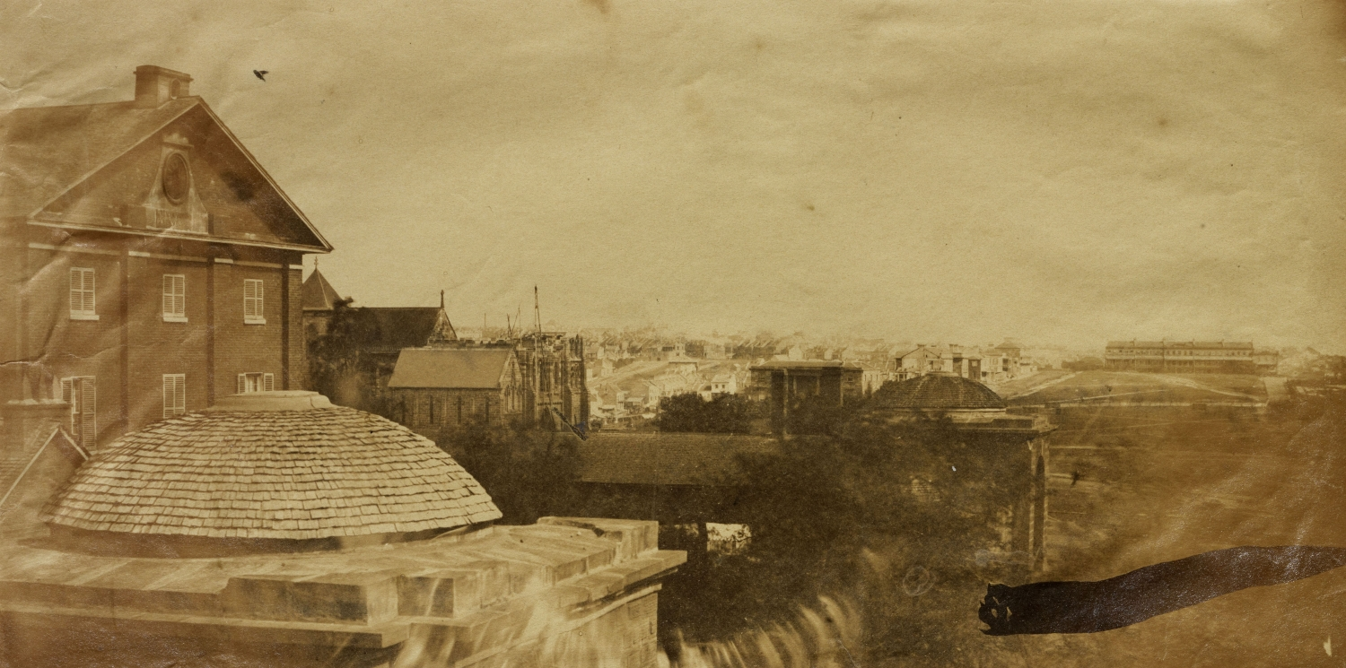 Sweeping sepia toned panoramic view of Hyde Park Barracks in 1857 including Hyde Park and beyond.