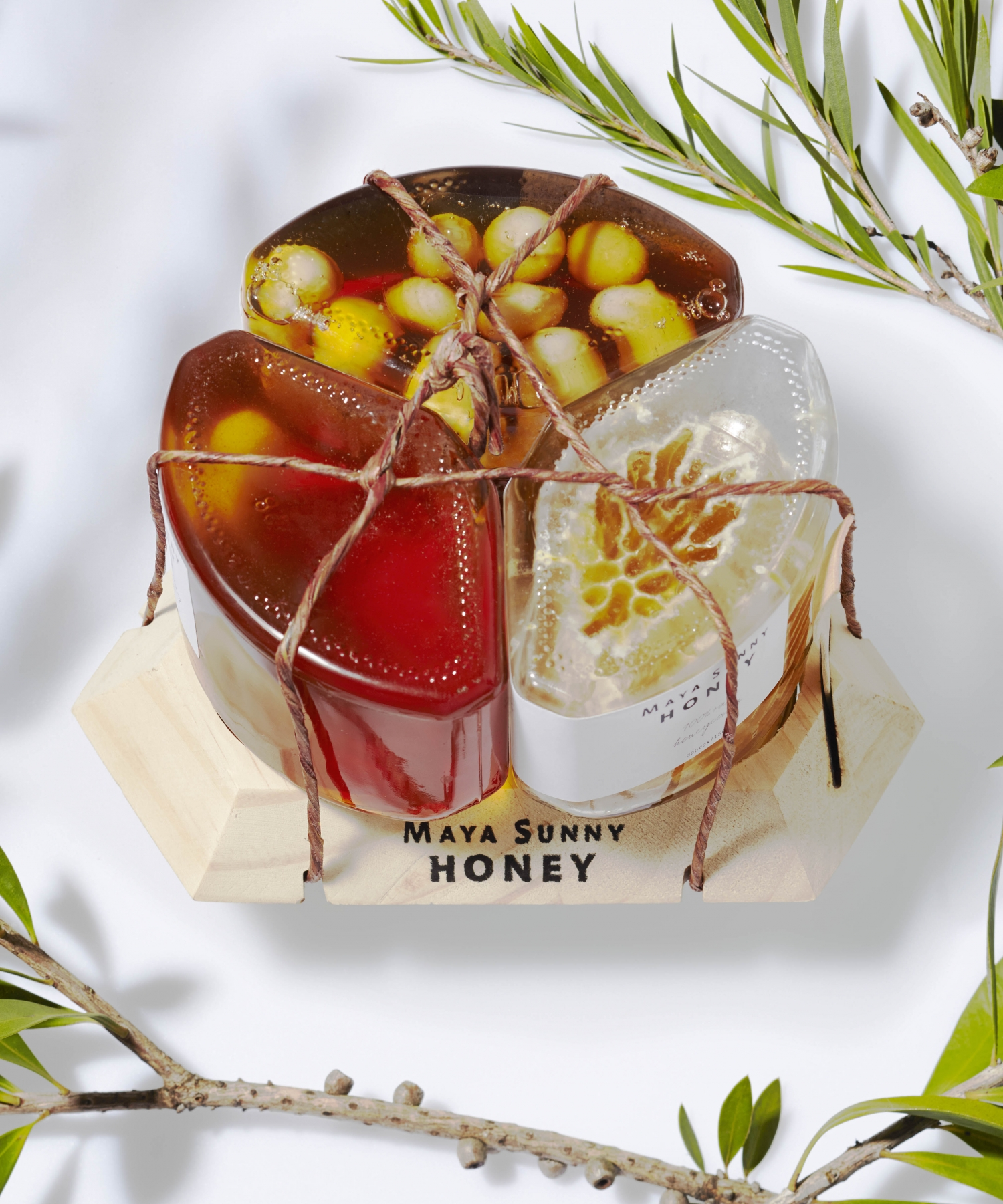 Three honey pack presented as gift with company name attached.