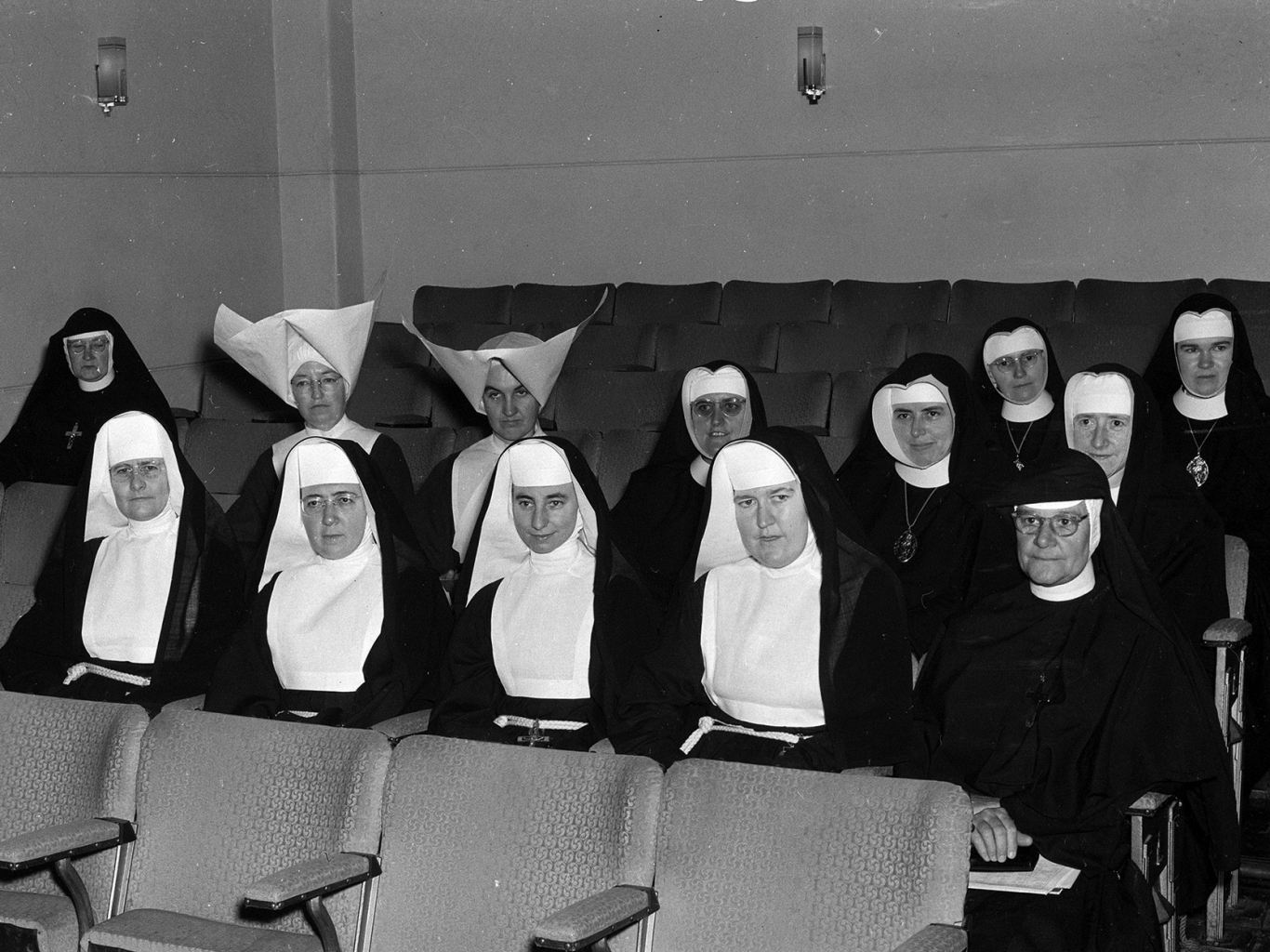 Group of nuns seated in rows.