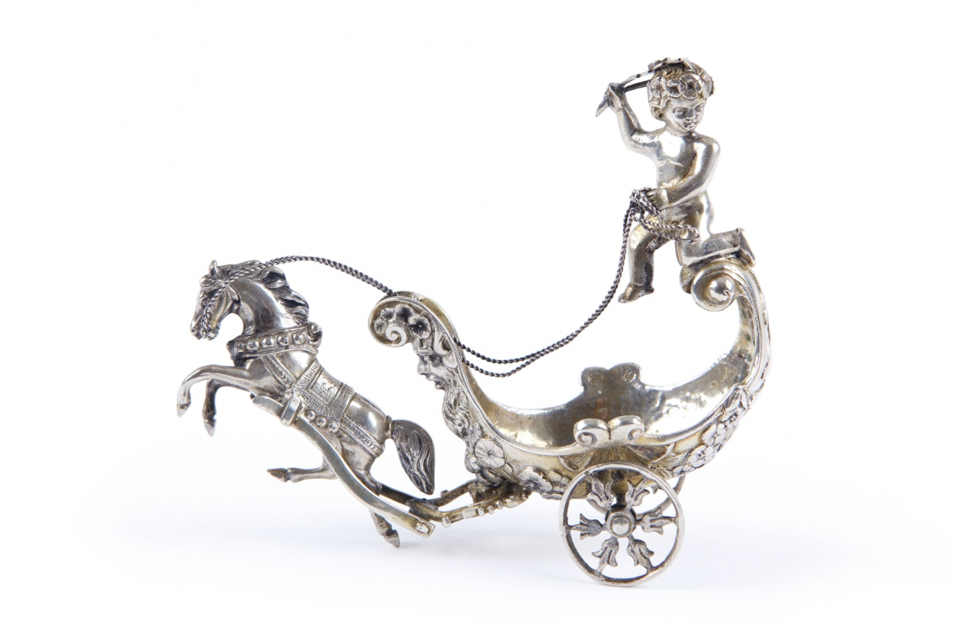 Silver stylised horse drawing a chariot.