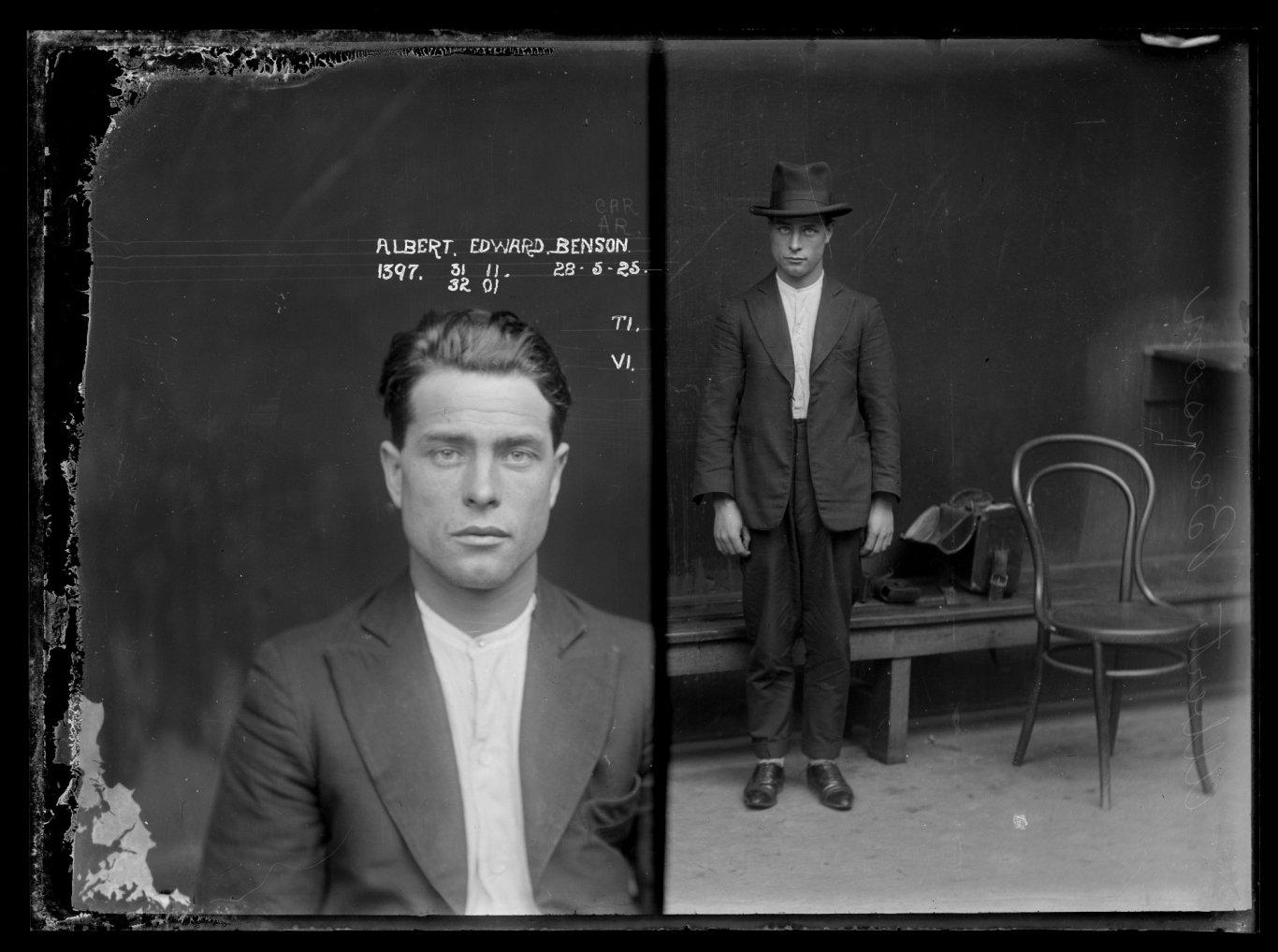 Dual mugshot in black and white; man seated and then man standing, with hat on. Photographer's bag on table behind man.