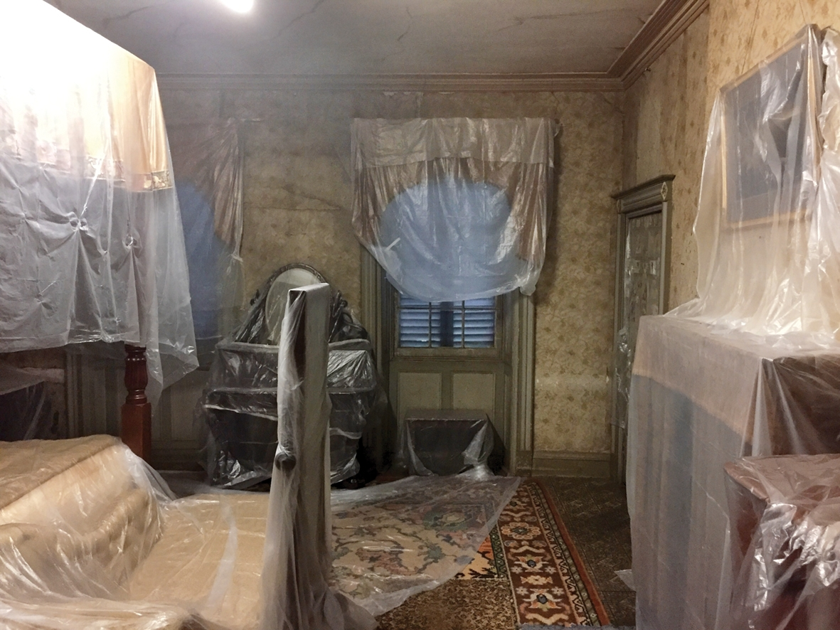 Room draped in plastic sheeting.