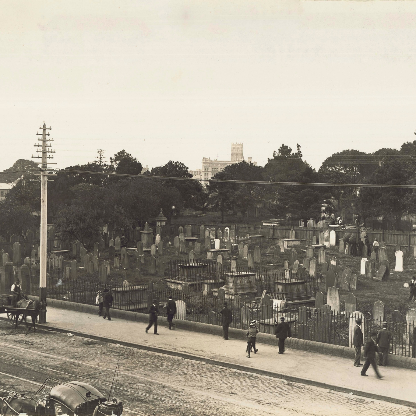 Black and white view of cemetery.