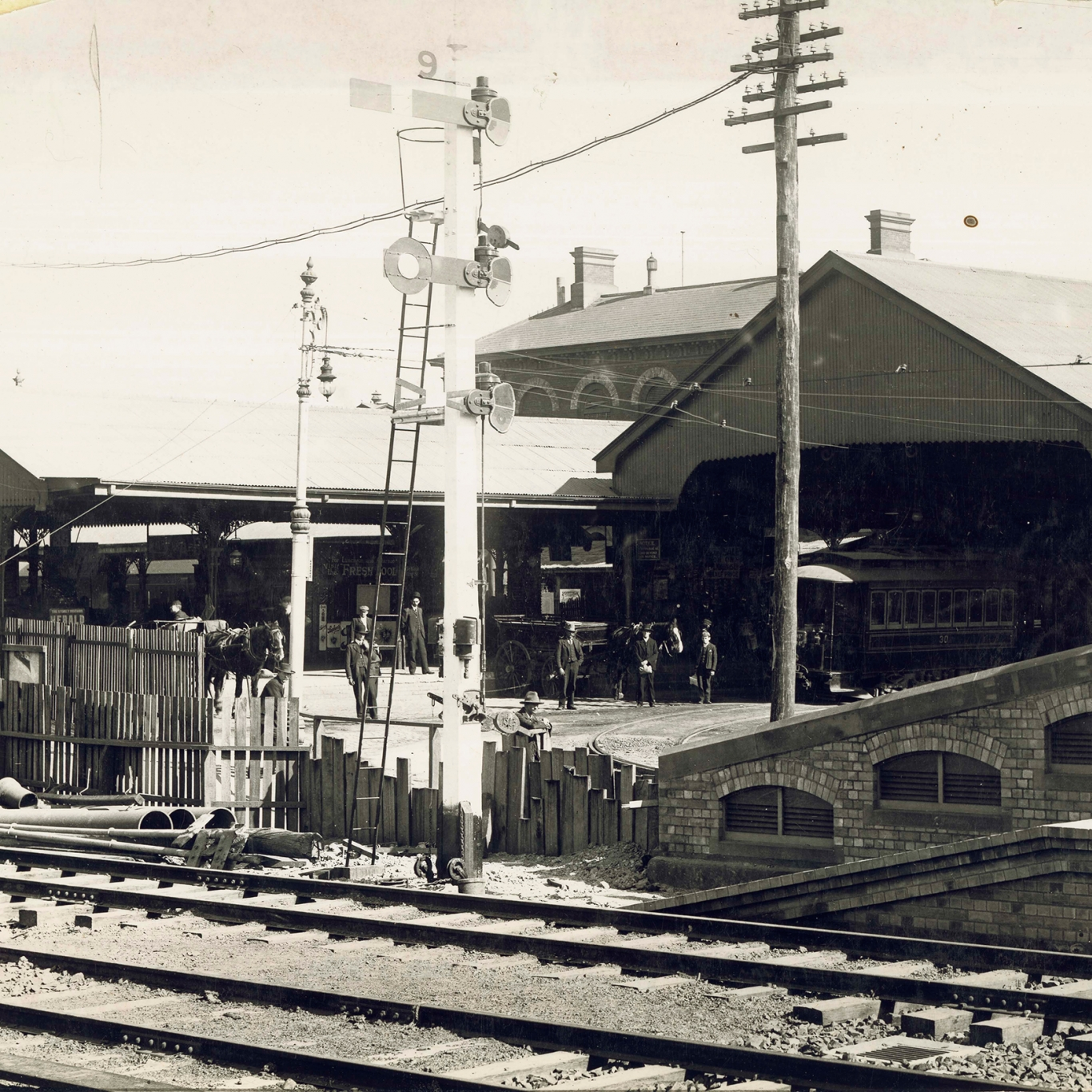 Black and white photo of station and tracks.