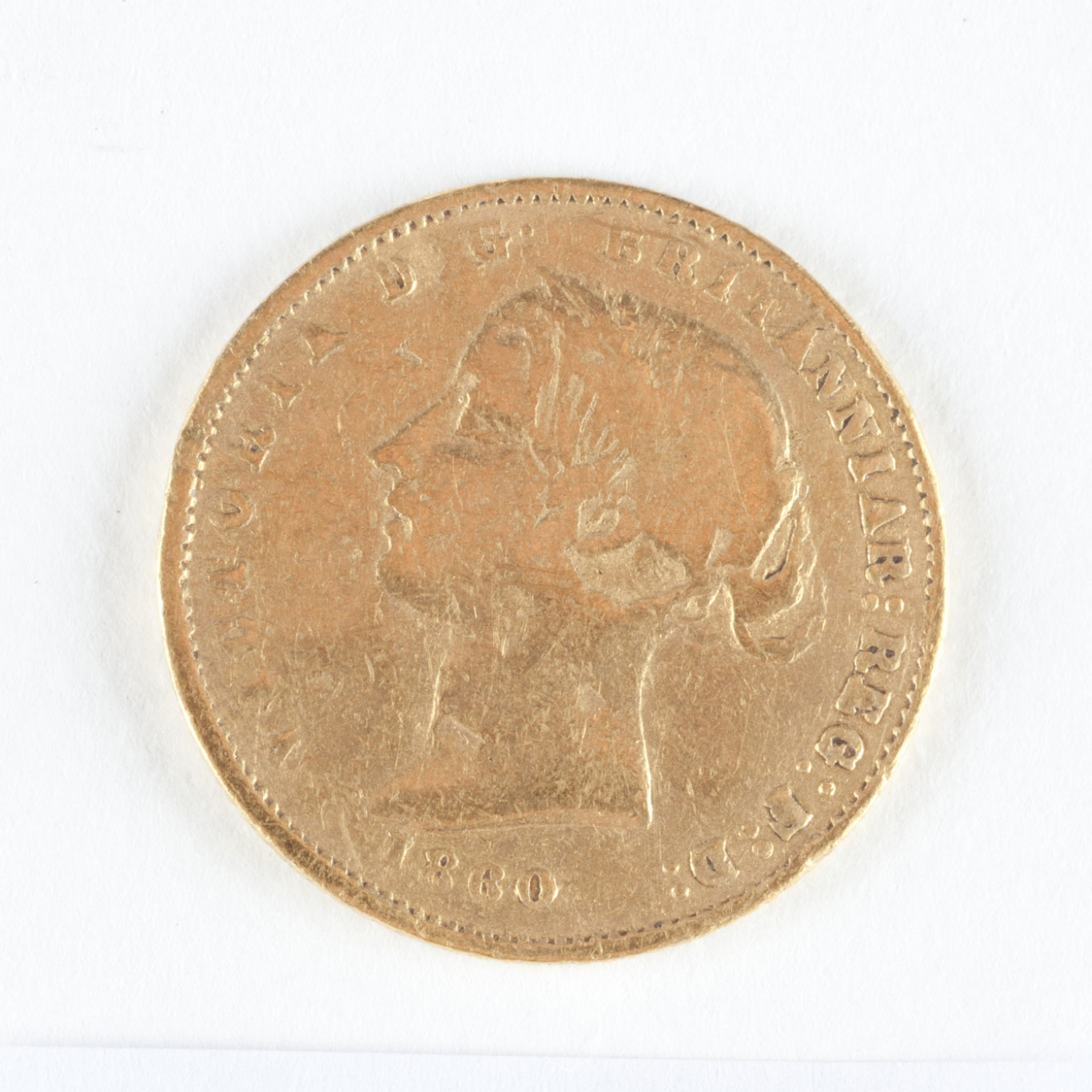 Gold coin with head on it.