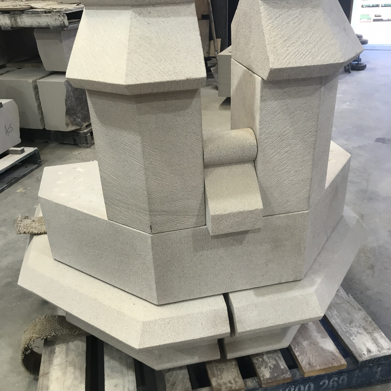 Sandstone piece cut to shape of turret.