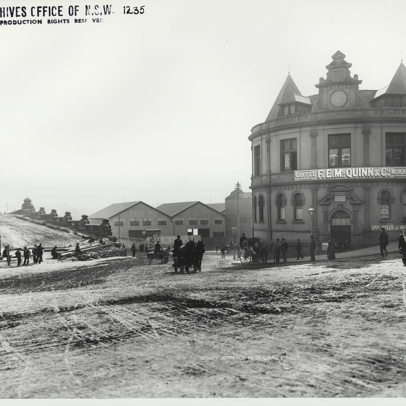 Black and white photograph of road with building to right.