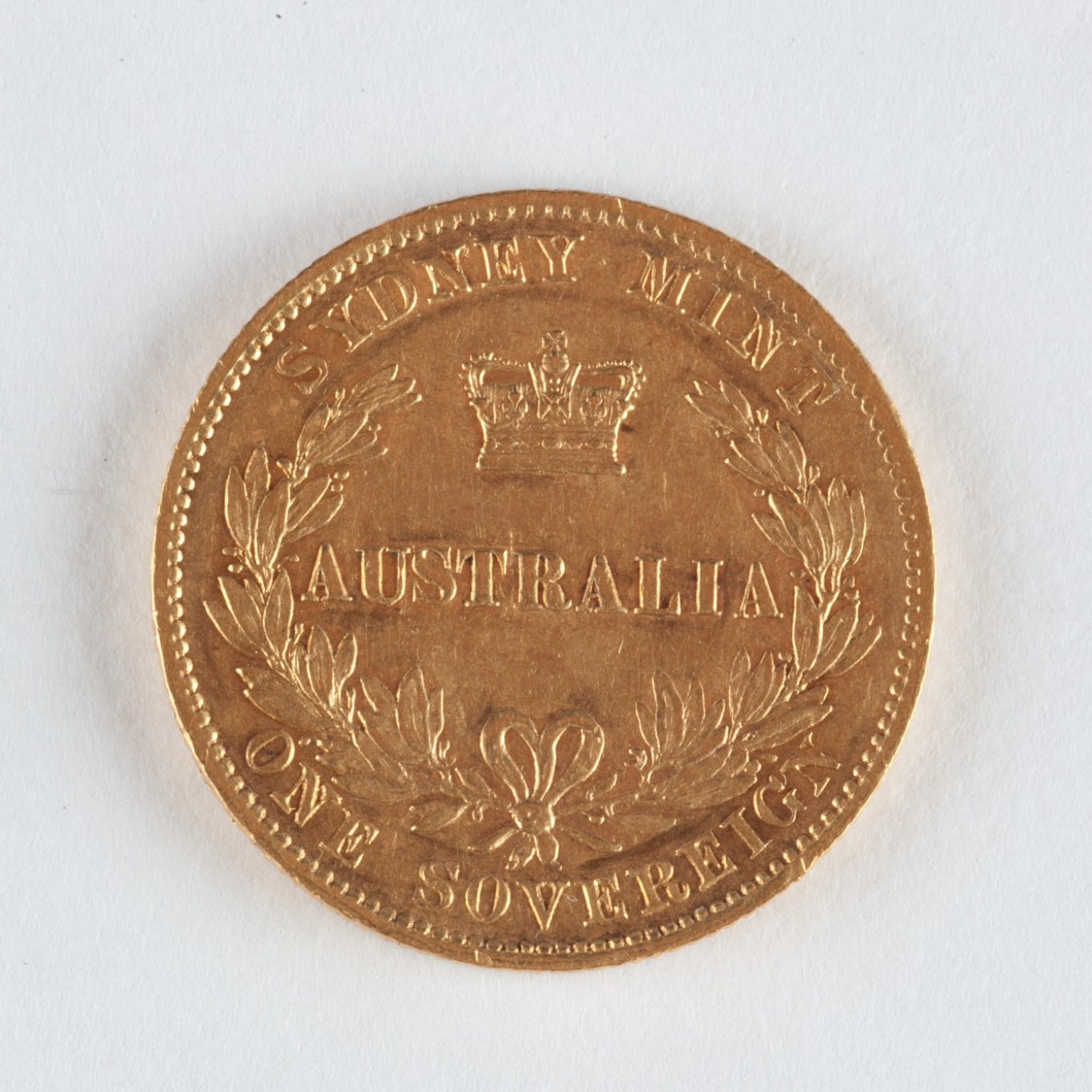 Reverse of gold coin.