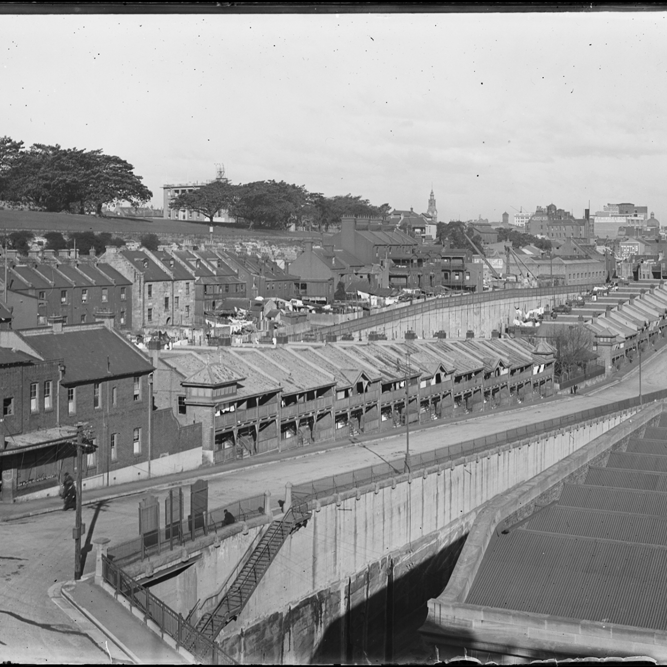 Black and white photograph of rows of terrace houses.