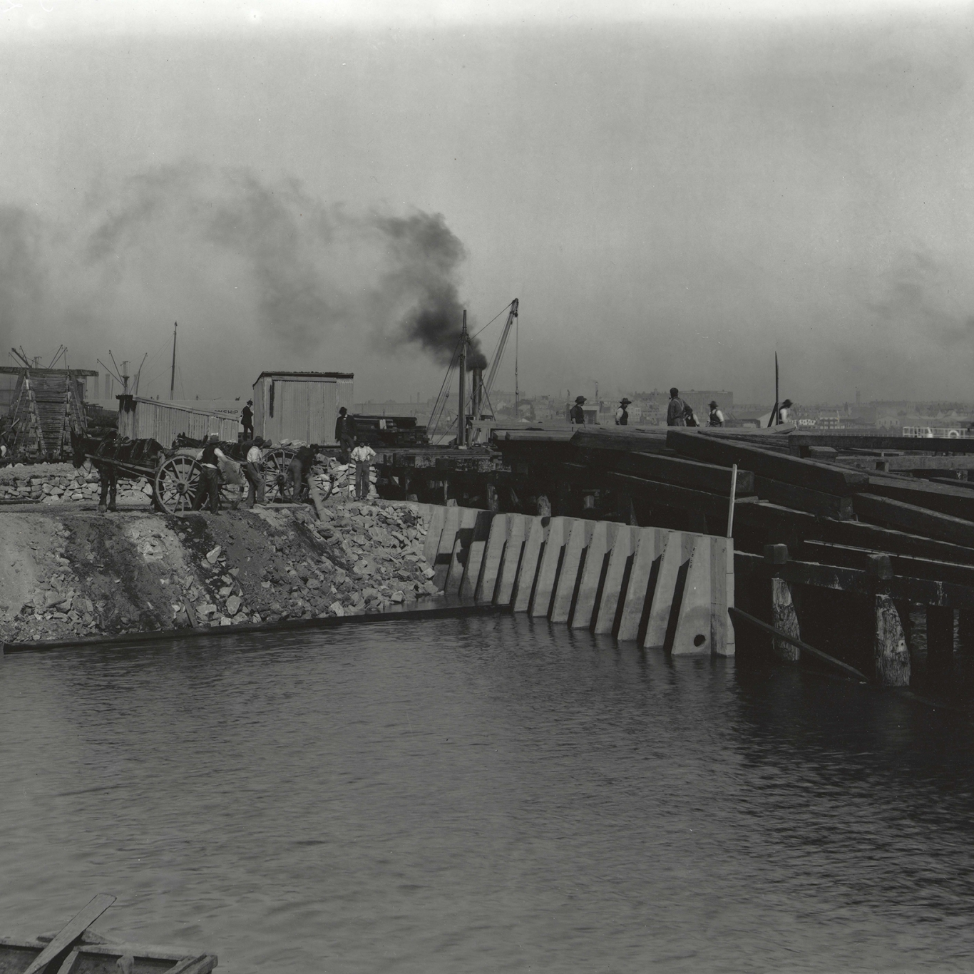 Black and white photograph looking across water.