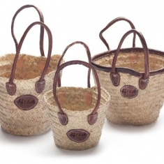 Three sizes of woven basket with handles.