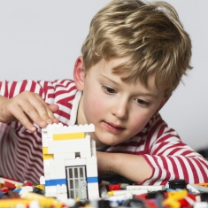 Boy building a tower.