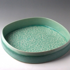 Green glazed ceramic dish.
