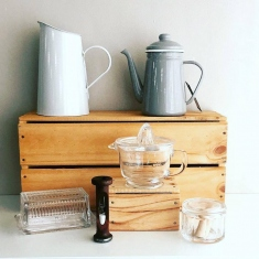 Homewares displayed on wooden crates.