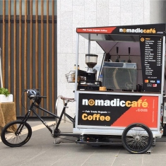Bicycle with coffee cart attached.