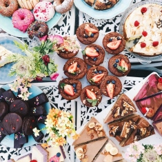 Mixed selection of gourmet donuts.