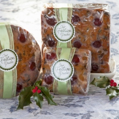 A collection of Christmas puddings with labels/wrapping.