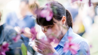 Image of girl with flowers in foreground