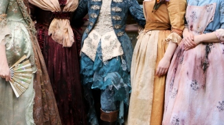 Detail of five costumes on models.
