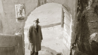 Detective at foot of Argyle Steps, The Rocks (Sydney), late 1930s.