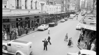 View down King Street from Pitt Street, Sydney City, officer in uniform directing traffic