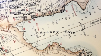 Old map of Sydney Cove as part of exhibition space.