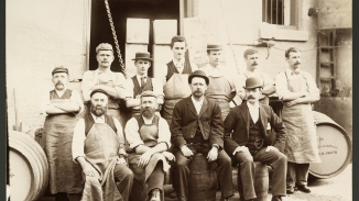 Old photo of men outside a brewery