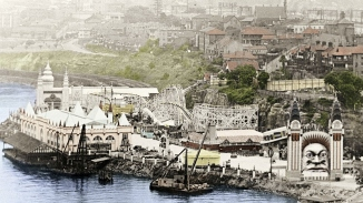 Handtinted black and white photograph of amusement park from above.