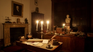 The library, lit by candle light at Elizabeth Bay House