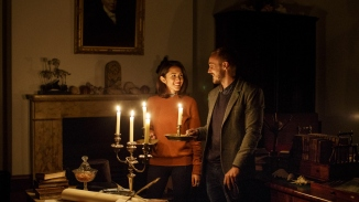 Paul Bennetts and Julie McTernan in the Library, lit by candle light at Elizabeth Bay House.