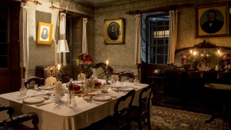 The dining room of Rouse Hill House at night.