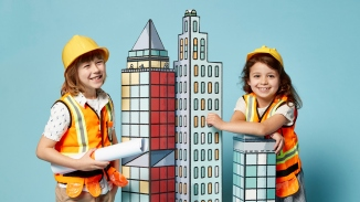 Promo image of two children with cityscape artwork.