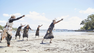Group of dancers on beach.