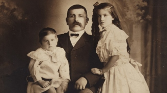 (Detail) Studio portrait of resident and shopkeeper Swedish-born Hugo Knut Ljunggren (Youngein) with two of his children, Herbert and Jenny, c1910.