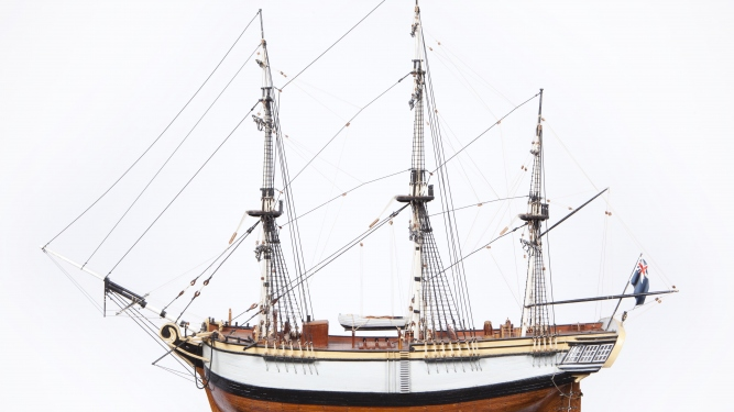 Photograph of a wooden model depicting a First Fleet ship.