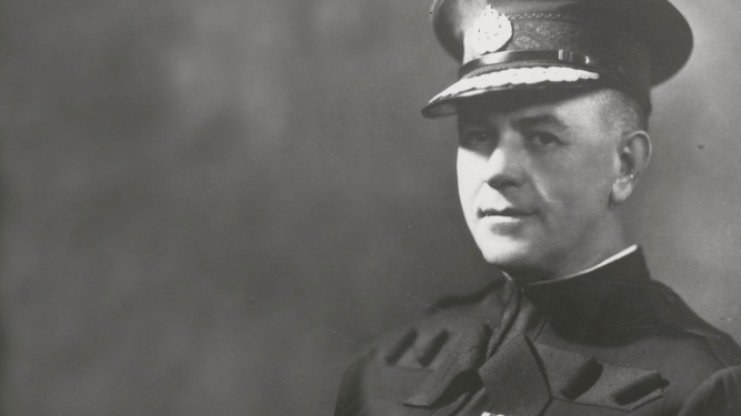 Black and white photographic portrait of man in uniform.